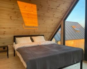 Wnętrze domku sypialnia